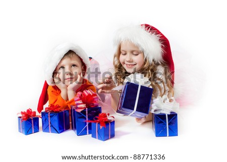Girl and boy with the Christmas gifts