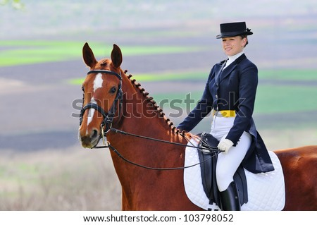 Girl and dressage horse - stock photo
