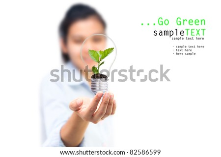 Girl and green tree light bulbs, Symbol of go green concept