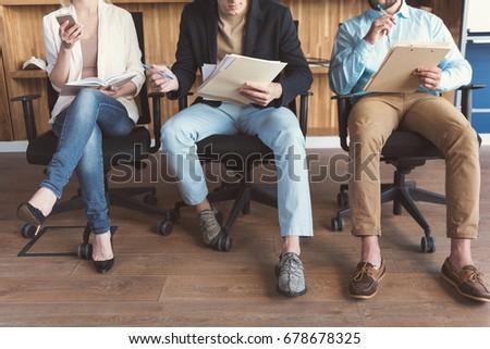 Girl and guys waiting for job interview in queue indoor - Shutterstock ID 678678325
