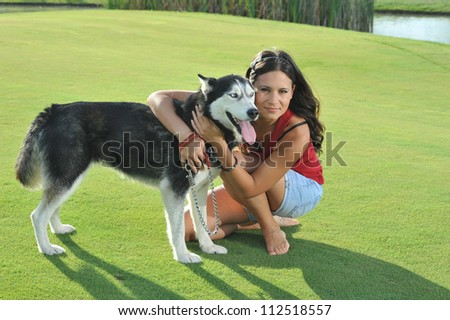 girl and her faithful husky - stock photo
