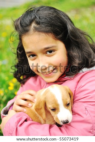 Girl and her puppy