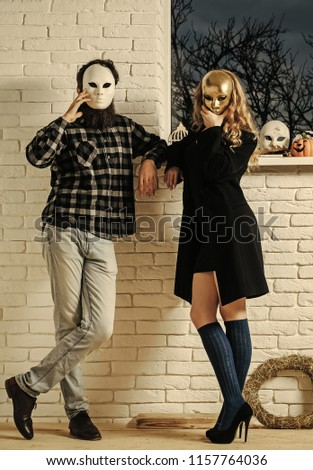 Girl and man in mask stay at window. Carnival, masquerade, masque party, holiday celebration. Decoration, amusement, protection, disguise pretense concept