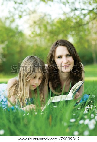 Girl and mother reading the book