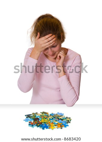Girl and puzzle, isolated on white background