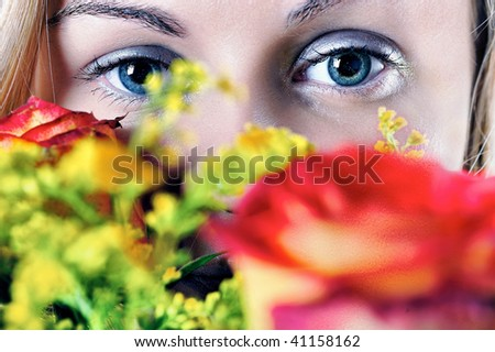 Girl and roses : Beautiful young woman\'s face fragment with colour roses over.