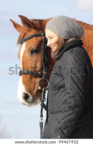 Girl and Russian Don horse outdoors