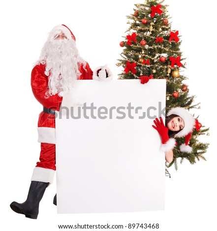 Girl and Santa Clause by Christmas tree holding banner. Isolated.