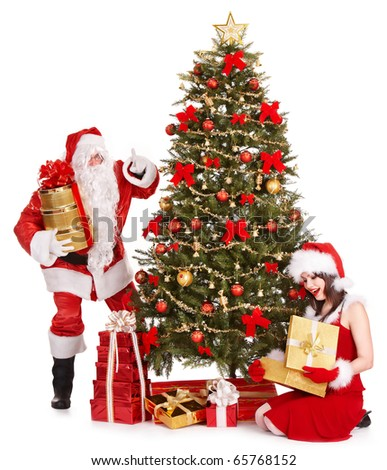 Girl and santa clause by christmas tree. Isolated.