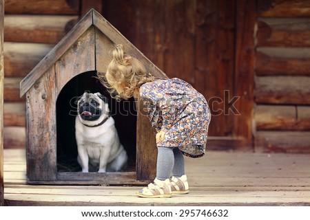 girl and small dog, dog house