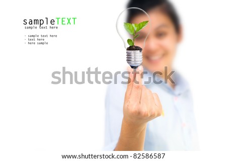Girl and tree in light bulbs, Symbol of environmental protection concept - stock photo
