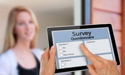 Girl answering survey questionnaire interview on tablet
