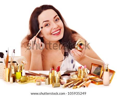 Girl applying makeup. Isolated.