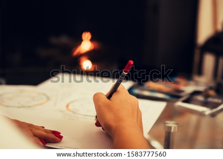 Girl artist draws a sketch with a pencil. Hand drawing. Drawing a portrait. Selective focus