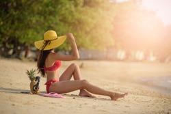 Girl Asian On Beach Summer Vacation, Young Woman Back  View Sit On Sand Sea Ocean Holiday Travel. women summer bikini vocation friend freedom. Pattaya beach Thailand.