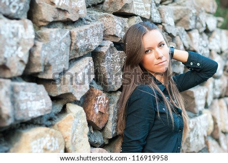 Girl at a stone protection