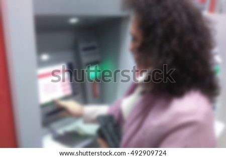 Girl at ATM blurred. #492909724