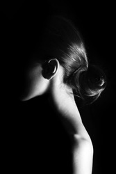 Girl at black background. Photo in black and white style.