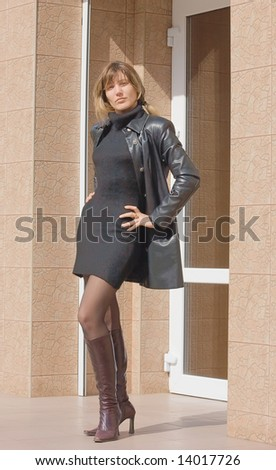 f98039d2e952 Girl in a gray mini dress and black… Stock Photo 382376356 - Avopix.com