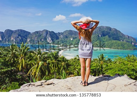 Girl at the resort in a dress on the background of the bays of the island of Phi Phi Don