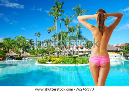 Girl at tropical swimming pool. Collage.