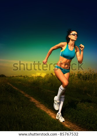 girl athlete runs on road