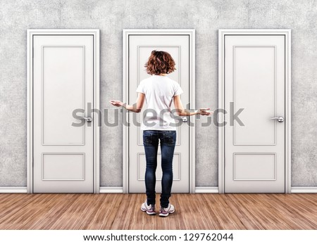 Girl before a white doors in fear of the unknown