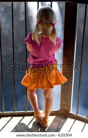 Girl behind the bars