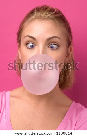 Girl blowing a big bubble gum bubble