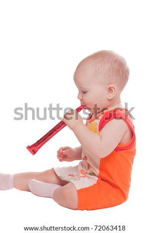 Girl blowing to horn isolated on white