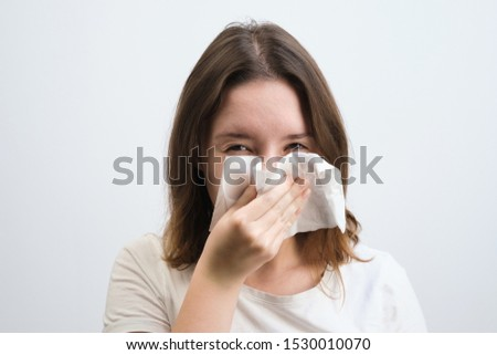 girl blows her nose in a handkerchief with a cold #1530010070