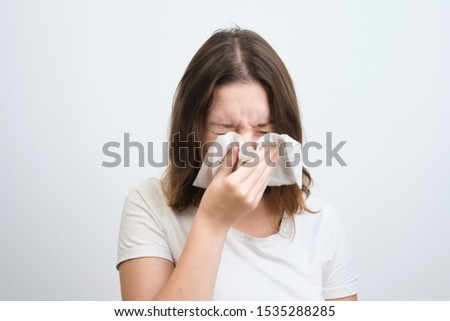 girl blows her nose in a handkerchief with a cold #1535288285