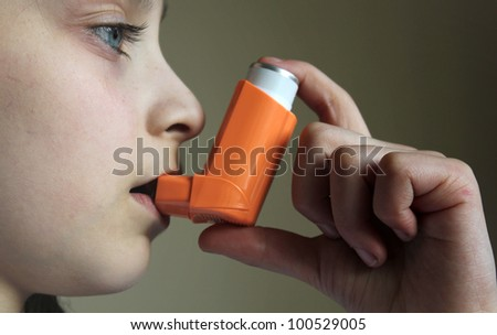 Girl breathing asthmatic medicine healthcare inhaler