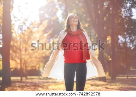 Girl breathing deep to feel autumn atmosphere