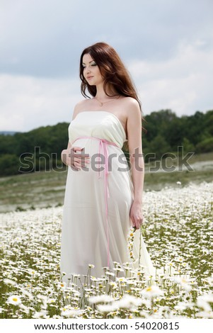 Girl Bride resting in a field of flowers