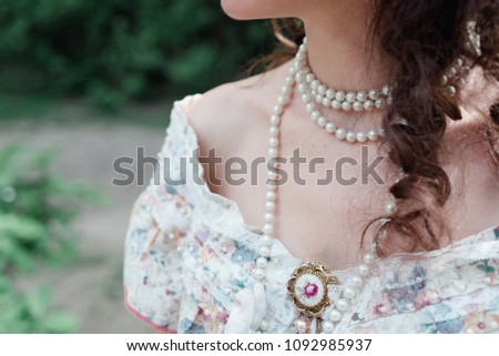 girl bride with pearls, vintage brooch and bare shoulders #1092985937
