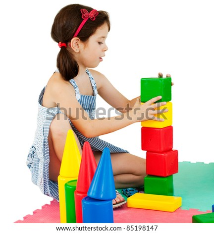 Girl building with colorful blocks
