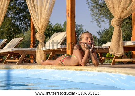 Girl by the poolside