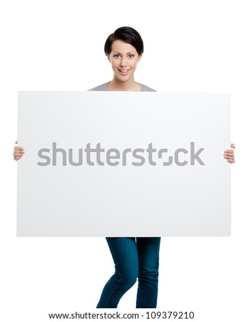 Girl carries a huge sheet of white cardboard , isolated on white
