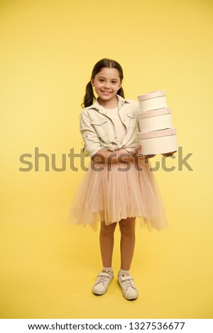 Girl carries pile boxes. Prepare shopping sale season. Prepare for school season buy supplies stationery clothes in advance. Back to school season great time to teach budgeting basics children. #1327536677