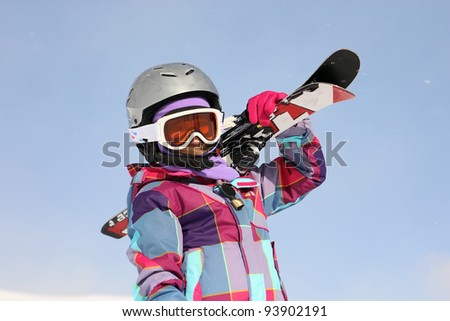 Girl carrying skis