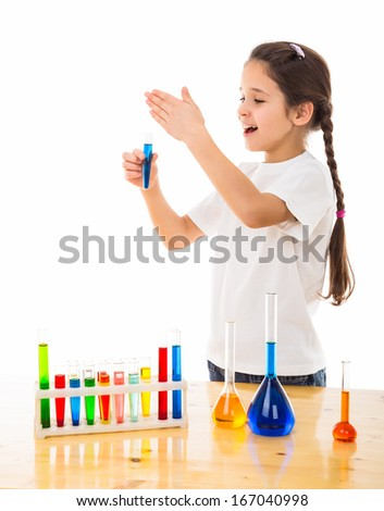 girl cautiously sniffs a chemical reagent, isolated on white