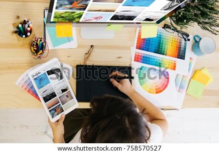 girl checking portfolio at design studio