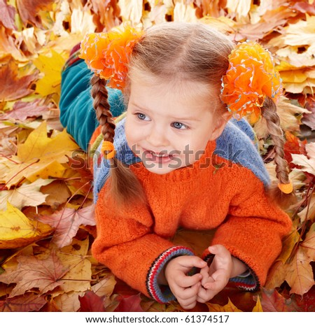 Girl child in autumn orange leaves. Outdoor.