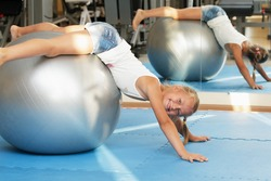 Girl child on a gym ball
