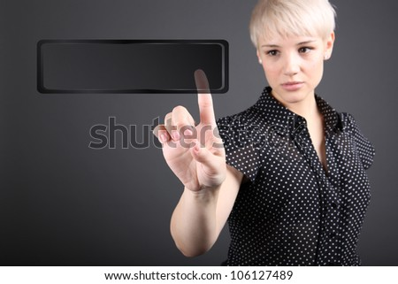 Girl choosing photo from touch screen - modern photography concept