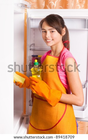 Girl cleaning kitchen