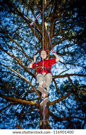 Girl climbing in adventure park