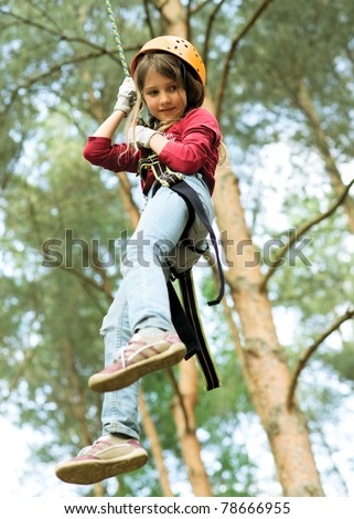 Girl climbing in forest