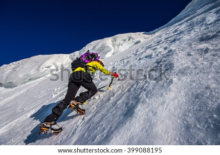 Girl climbing the mountain on snow field #399088195